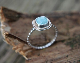 Unique Aquamarine Ring Handcrafted in Sterling Silver and Gold Halo atop a Beaded Band of Silver