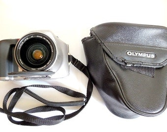 Olympus IS 200  IS-20 Film Camera, the First SLR with an integrated Lens Cap & Case