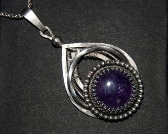 Sterling silver handmade pendant with Amethyst