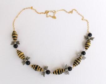 Bumblebee paper bead necklace.