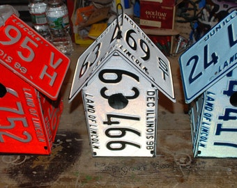 A birdhouse built from new old-stock license plates.