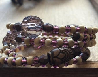 THE LAMBARI BRACELET - Multi strand memory wire.wood beads.purple beads.polished acrylic translucent beads and tribal beads.No clasp.