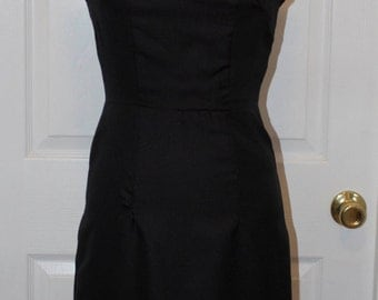 Fitted Black Dress with Cap Sleeves and Pleated skirt
