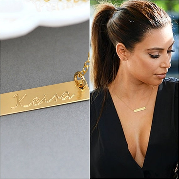 Celebrity name plate necklaces