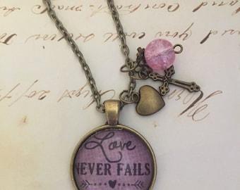 "1 Corinthians 13:8 ""Love never fails"" glass pendant necklace with charms"