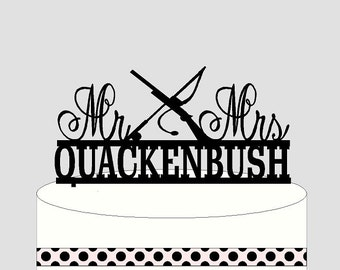 Hunting Fishing Cake Topper Personalized with your Surname and Mr and Mrs. Shotgun and Fishing Reels on this cake topper.