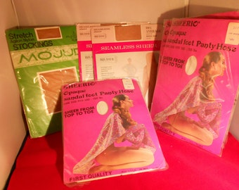 Vintage lady's stockings and pantyhose by Mojud,Gaymode, and Sheerios. Six pair! The hosiery is brand new in original packaging.