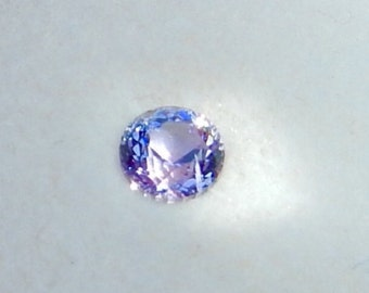TANZANITE - .81 cts. - Sparkling Violet Blue - 5.25 mm Round Brilliant Cut with 135 Facets! - Extremely Brilliant Gemstone! - #0261
