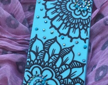 Deco phone case. beautiful light blue cover hard plastic case for iphone 5. hand painted black with blue rhinestones.
