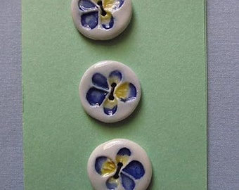 Three White Ceramic Buttons with Blue and Yellow Flowers