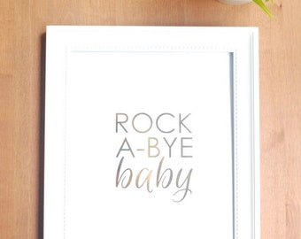 gold foil print: gold typography rock a bye baby nursery art