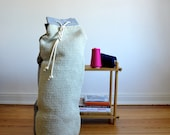 bean bag or laundry bag with hand knitted front part made of lambswool