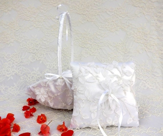 White flower girl basket and wedding ring pillow decorated with embroidered chiffon leaves and flowers