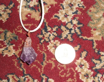 Amethyst, copper wire wrapped, on cord