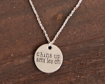 Chins up Smiles on - Hand Stamped Stainless steel necklace ~ Hunger Games Quote ~ Effie Trinket ~ Quote with meaning ~ Hypoallergenic