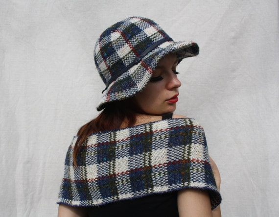 Traditional tartan scarves and capes, available in both lambswool and cashmere.