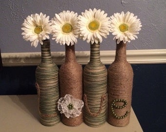 Green & Jute Wine Bottles that Spell Love with Gerber Daisies