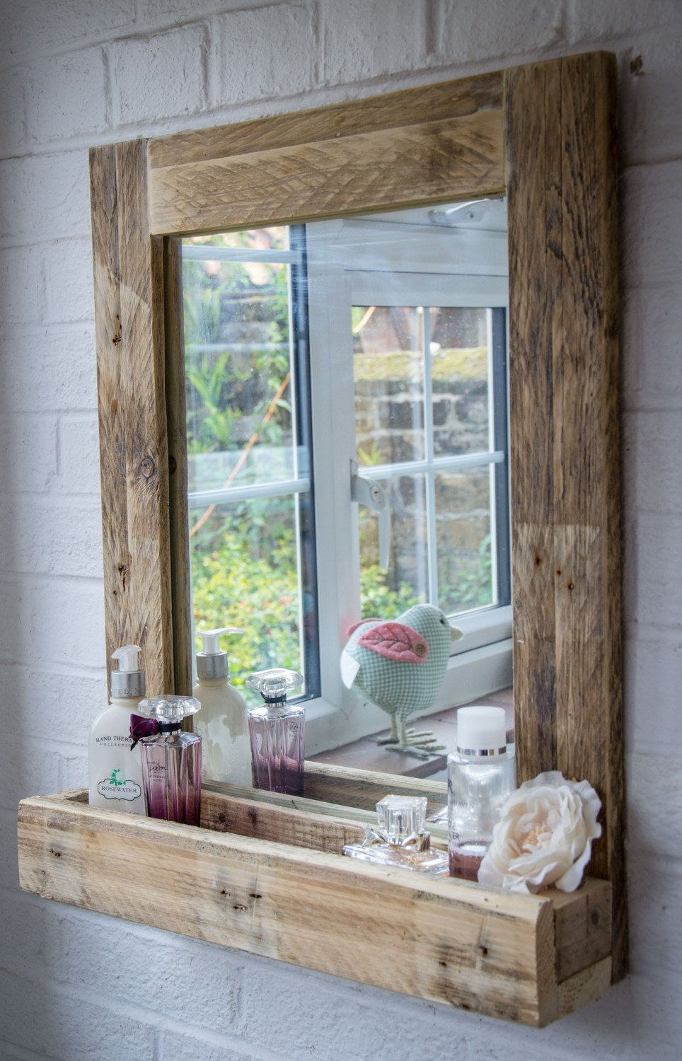 Rustic bathroom mirror made from reclaimed pallet wood for Custom made mirrors for bathrooms