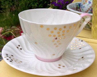 Queen Anne Teacup and Saucer, Gold Stars on White Background With Pink Accents
