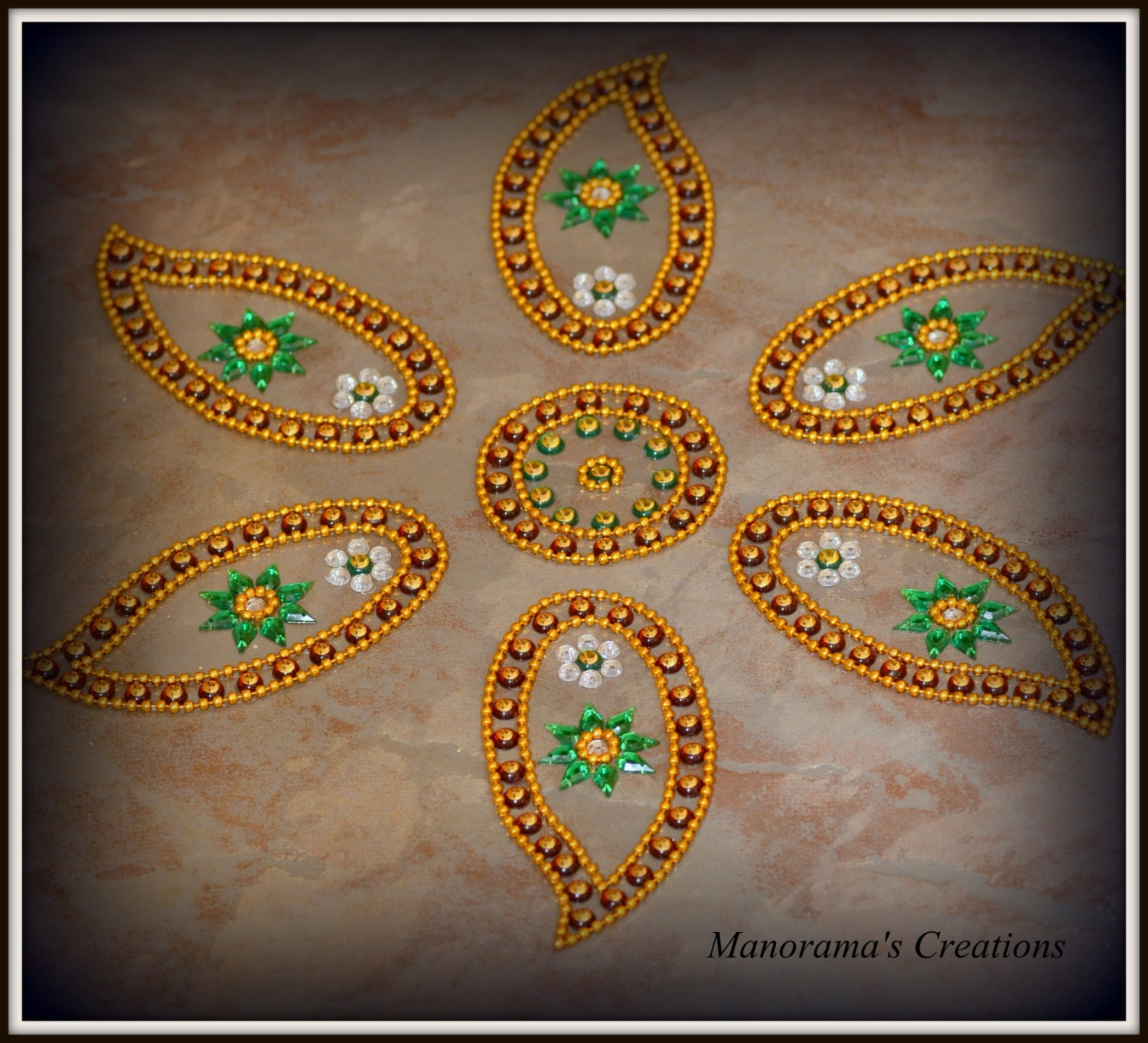 Petal floor art kundan rangoli design by manoramasjewellery for Floor rangoli design