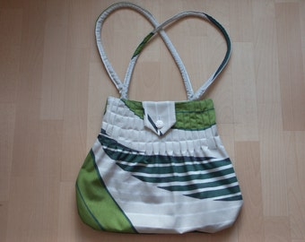 Handbag with green leaves - there is no postage charged