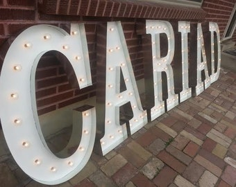 7 LETTERS Marquee light signs.