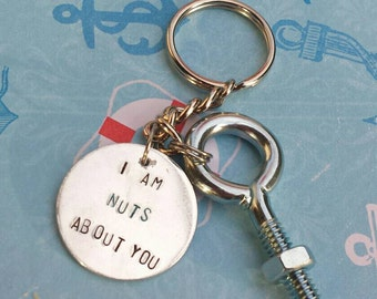Keychain gift for husband/boyfriend/wife/girlfriend.  Hand stamped on light weight aluminum, real nut and bolt.  High quality key ring.