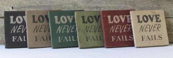 Love Never Fails Wooden Desktop Sign with Optional Wall Hanger