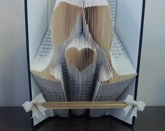 Book folding art pattern for celebration / wedding glasses