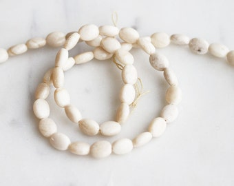 A2-650-08-6] Ivory Fossil / 6 x 8mm / Smooth Oval Bead  / 1/2 strand