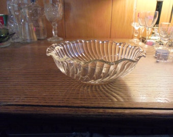 Fostoria swirl bowl with ruffled edge.
