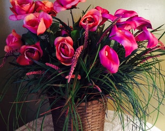 Deep Rose Colored , Aged Roses. Calla Lilies, with Deep Plum color and  Assorted Grasses, different Color Hues. Dark Brown Wicker Basket