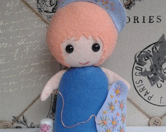 The Little Felt Girl who loves to Stitch