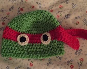 red, orange or blue ninja turtle hats!