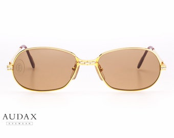 """Vintage Cartier """"panthere"""" P.M. sunglasses n. series E063036 / gold plated frame / original from 1989"""