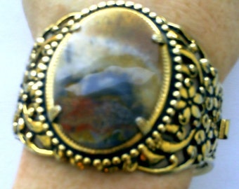 Fabulous ornate vintage wide goldtone hinged bangle bracelet with picture agate