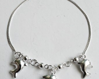 Sterling silver bracelet with dolphins
