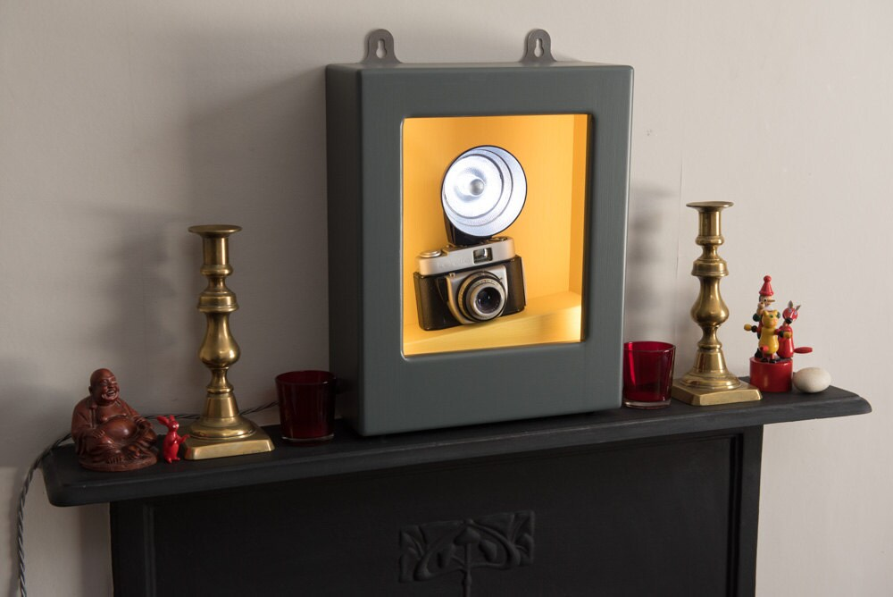 Wall light or table lamp with vintage camera and flashgun in