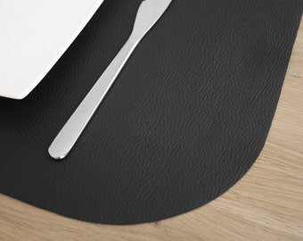 Together of 8 place mats in black imitation leather