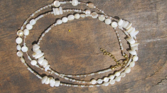 CREMA custom made waist beads, glass beads, creamy dyed natural stones, ivory white and pinky beige seed beads, Trade