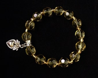 Yellow Beaded Bracaelet with a Heart Charm