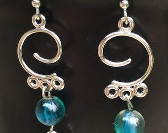 Blue bead and flower dangle earrings