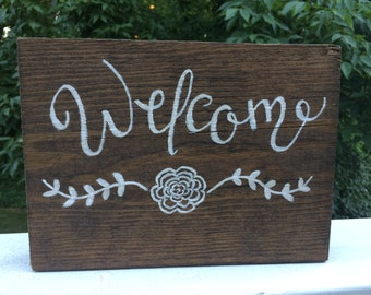 "Hand-painted wooden ""Welcome"" sign"