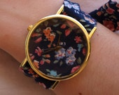Multicolor clock of dark blue floral printed fabric and flowers