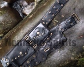 Black leather festival belt with metal studs and scallop pattern nade with recycled bits if leather
