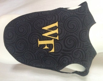 Embroidered Wake Forest logo reversible bib that covers a large area on the child.  Cotton on the front and flannel on the back.