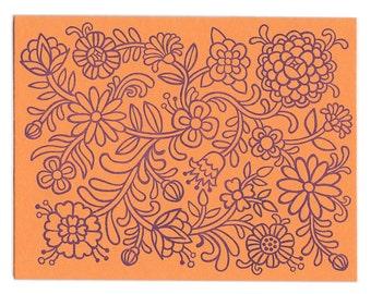 set of five handmade letterpress Orange Flower Power greeting cards