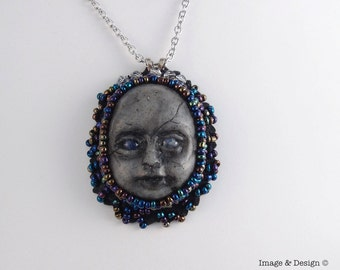 Hand Beaded Hand Sculpted Doll Face Cameo Necklace by Ugly Shyla One Of A Kind gothic creepy doll