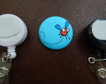 Orange Buzzing Fly Fabric Covered Button for Clip on Retractable Badge Reel