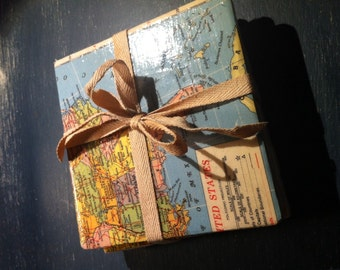 Four handcrafted map coasters